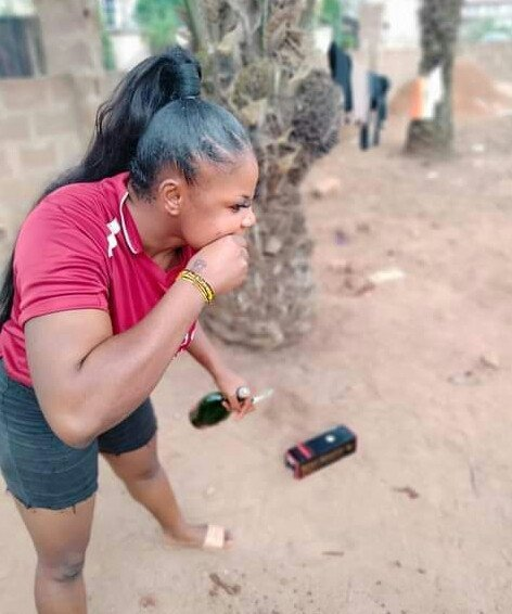 Lady brushes her teeth with a bottle of N28k Remy Martin VSOP (photos)